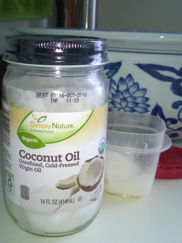 This jar of Simply Nature coconut oil was less than $5 at my Aldi's.  For use in the bathroom, I scoop a little into a plastic container then put the jar back in the pantry.