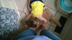 Angel Baby laying across Princess on my feet shortly after I finished my business on the throne.